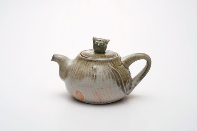 133. $120. 150ml pure porcelain-20%stoneware-shino-soda.jpg